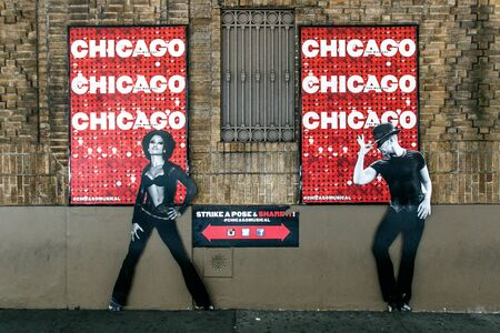 Sign on the exterior of the Ambassador theater inviting passerbys to strike a pose for a photograph. The theater is staging Chicago the musical. Editorial