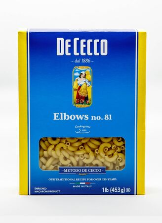 Package of De Cecco elbows number eighty one pasta against white background. Editorial