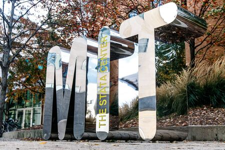 MIT, large metal letters, in the hear of the Stata Center at the Massachusetts Institute of Technology.