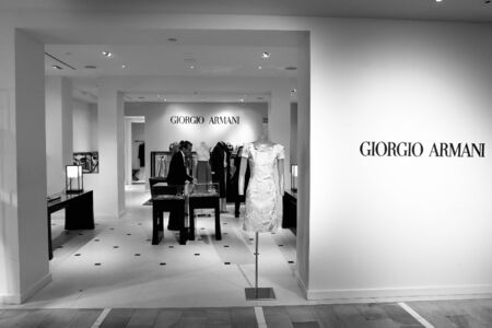 New York, 3/11/2019: Male employee is working at the Giorgio Armani section at Bloomingdale's department store in Manhattan. Imagens - 133574753