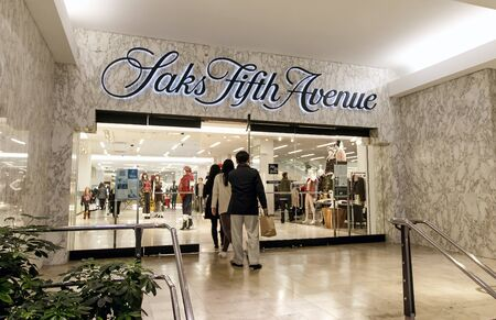 People entering a Saks Fifth Avenue department store located at Prudential Center in Boston.