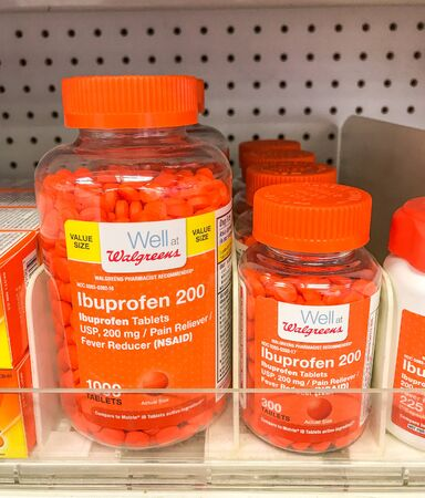 New York, 2272019: Bottles of Ibuprofen stand on a shelf at a Walgreens drug store.