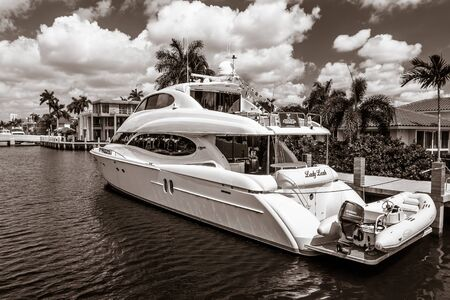 Fort Lauderdale, FL, 5172019: Private luxury yacht is docked at a private home on Las Olas Boulevard. Editorial