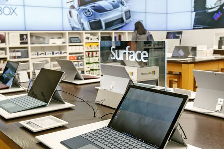 Variety of laptops running Windows Surface for sale at a Microsoft store in Prudential Center in Boston. Imagens - 133574768