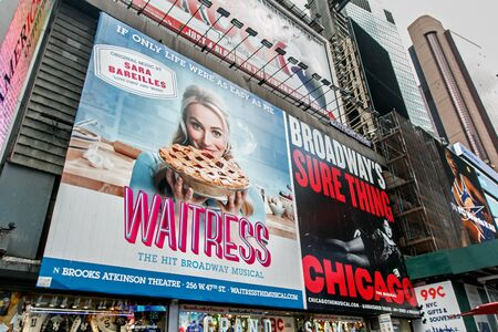 Large billboard advertising two Broadway musicals installed at Times Square. Imagens - 133574783