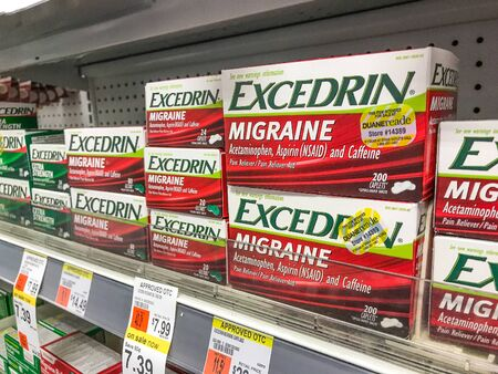 New York, 2/27/2019: Packs of Excedrin Migraine stand on a shelf at a Walgreens pharmacy.