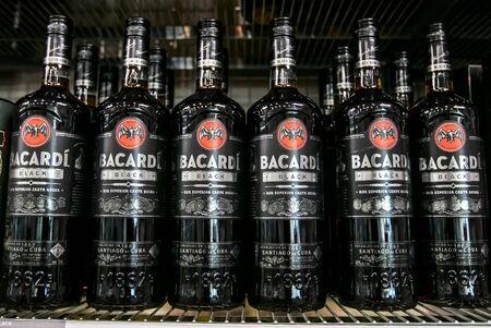 Aruba, 1222019: Bottles of Bacardi Black rum stand on a shelf in a liquor store. Editorial