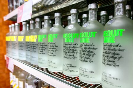 Aruba, 12/2/2019: Bottles of Absolut Lime and Absolute Citron vodka stand on a shelf in a liquor store.