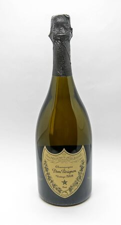 New York, 12/8/2019: Bottle of Dom Perignon champagne, vintage 2008, stands against white background.