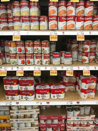 Park City, UT, 12/23/2019: Cans of Campbell's soup stand on shelves of a supermarket.