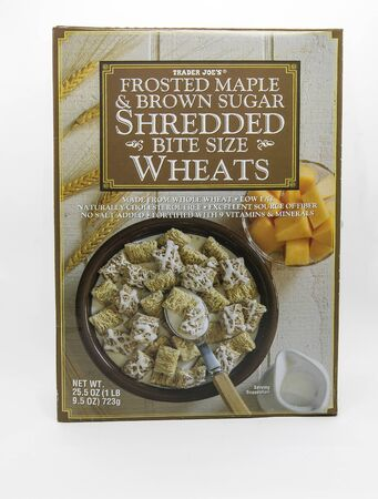 New York, 12/8/2019: Pac of Trader Joe's shredded bite size wheat cereal stands against white background. 免版税图像 - 138055996