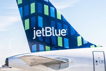 New York, 11/26/2019: Closeup view of a JetBlue jet's tail at JFK airport.