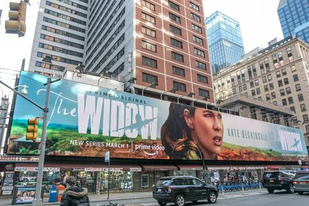 New York, 2/19/2019: Jumbo sized billboard for Amazon Prime original - The Widow - is put up on Broadway in midtown Manhattan. Editorial