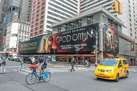 New York, 6/6/2019: Massive billboard for Good Omens - an Amazon original series - is installed along Broadway in midtown.