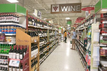 Fort Lauderdale, FL, 5/15/2019: People are shopping at the wine section of a Publix supermarket.