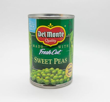 New York, 12/8/2019: Can of Del Monte sweet peas stands against white background.