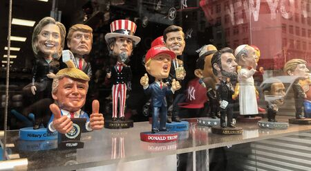 New York, 5/23/2019: Bobble head dolls of various political figures are seen on a gift shop's window display.