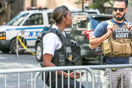 New York City, 9/27/2019: US federal agent and a Secret Service agent are part of police presence at a checkpoint in Manhattan during UN General Assembly.