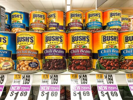 Basking Ridge, NJ, 08/02/2019: Bush's canned beans stand on a shelf of a Stop and Shop supermarket.