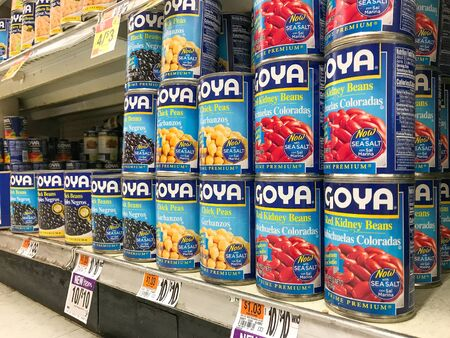 Basking Ridge, NJ, 08/02/2019: Goya canned beans stand on a shelf of a Stop and Shop supermarket. Editorial