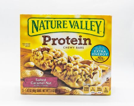 New York, 12/8/2019: Pack of Nature Valley salty caramel protein bars stands against white background.