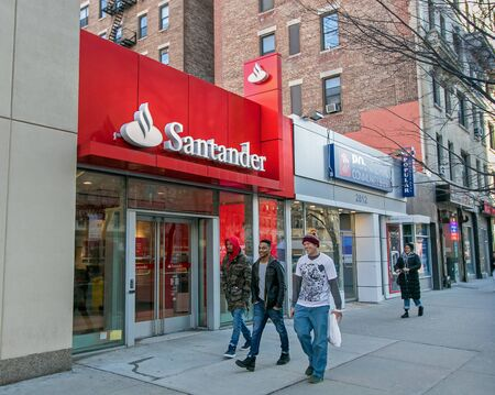 New York, March 11, 2018: People walk by a Santander bank branch in Manhattan.