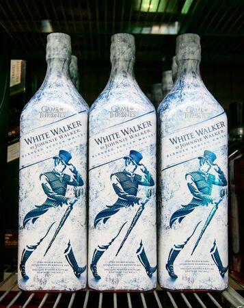 Aruba, 12/2/2019: Bottles of Johnnie Walker whiskey in Game of Thrones themed special packaging stand on a shelf in a liquor store. 免版税图像 - 138056058