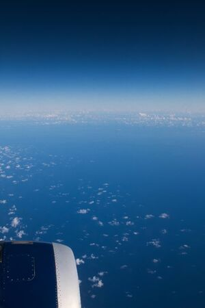 View from flying airplane. Long trip concept. World travel. 免版税图像 - 138243579