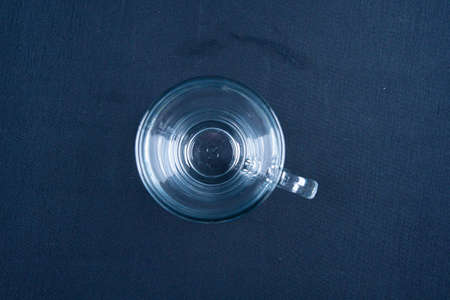 Empty glass on black background with mirroring