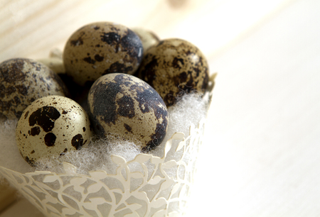 quail eggs in a paper basket