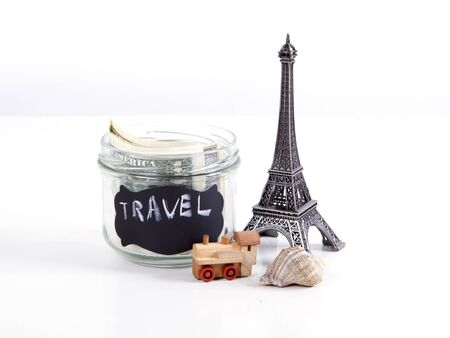 Travel to Paris, France concept with Eiffel Tower souvenir and wooden train toy. Planning summer vacation, money budget trip concept.
