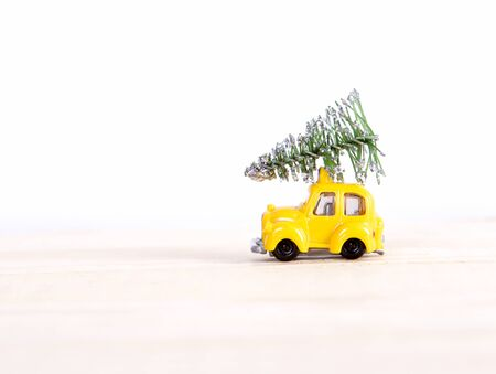 driven: car driven by the Christmas tree for the New Year