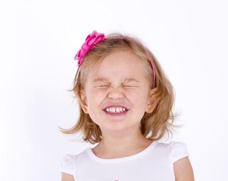 little girl close up strongly squeezed her eyes shut Reklamní fotografie