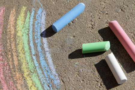 painted rainbow colored chalk on the pavement Stock Photo