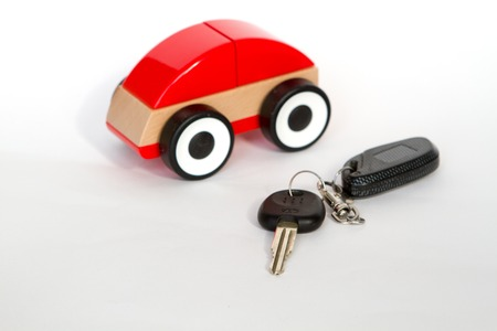 keyless: toy car red color on a white background with a remote control and key rent Stock Photo