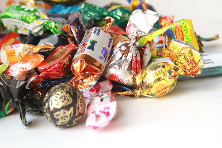 wrappers: pile of candies in colorful wrappers Stock Photo