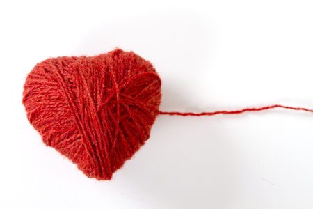 wool heart on white background