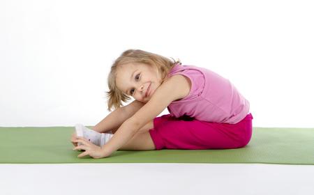 child doing gymnastics on a mat