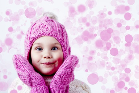 Girl in woolen hat and mittens