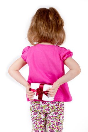 girl child hid behind a gift Stock Photo