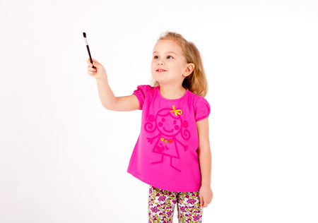 cute little girl drawing in the air or imaginary screen Stock Photo