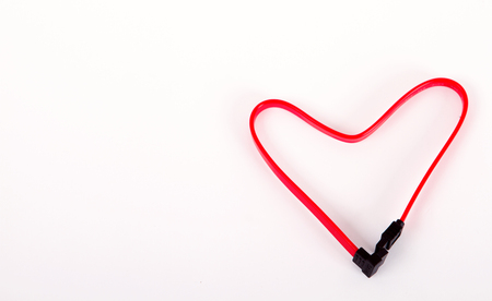 red wire folded in the shape of heart. Isolated on white Stock Photo