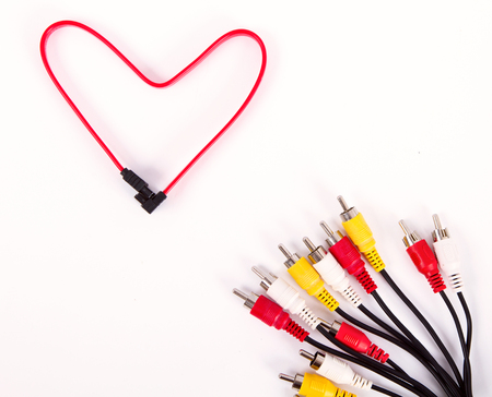 Color network cables isolated on white background in form of red heart. Online love and social networking concept. joining choice