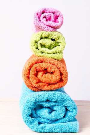 absorb: towels stacked rolls