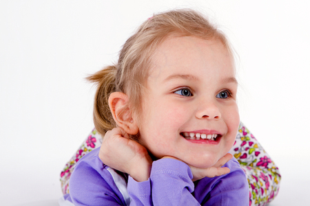 closeup image of a dreaming beautiful little girl Stock Photo