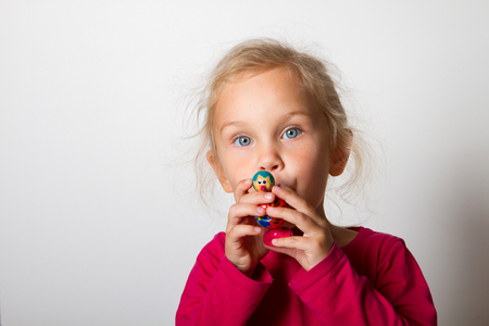 child blows into the whistle Stock Photo