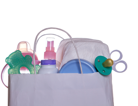 set of newborn baby things in paper bag isolated Stock Photo
