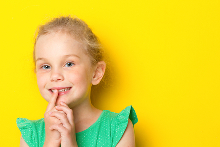 Kid making silence gesture Stock Photo