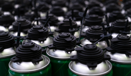 lot of foam cans standing in a hardware store Archivio Fotografico