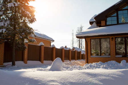 Winter home. fluffy white. Snowdrifts of white snow in front of the house, country life concept, winter in Russia.